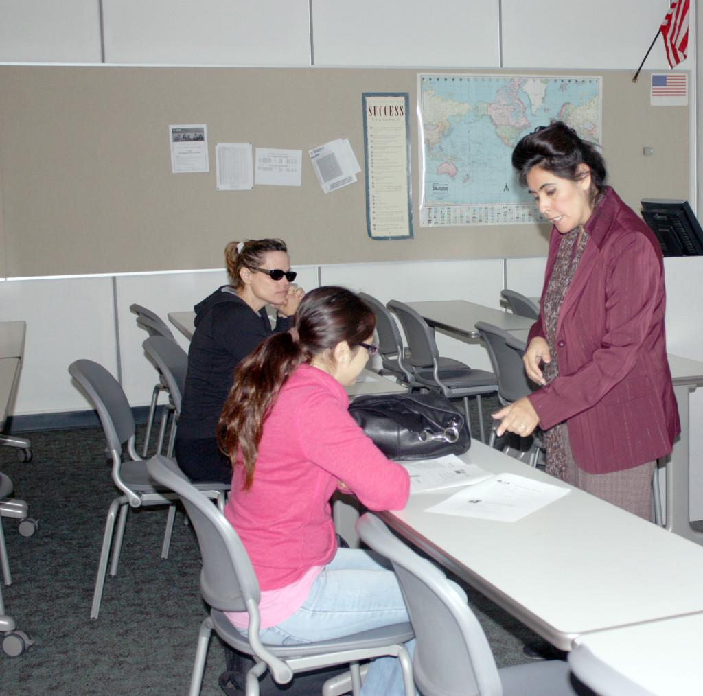 Disabled Students Center Counselor Aurora Segura demonstrates the correct way to approach employers at the job fair. The Job Fair and Career Expo will be on March 27 from 9:30 a.m. to 1 p.m. at the Library Sidewalk.
