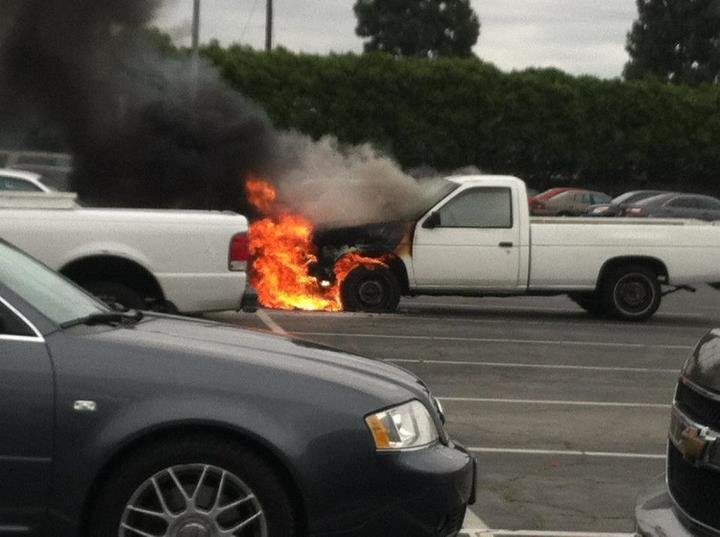 A truck on fire in the C-10 parking lot of Cerritos College