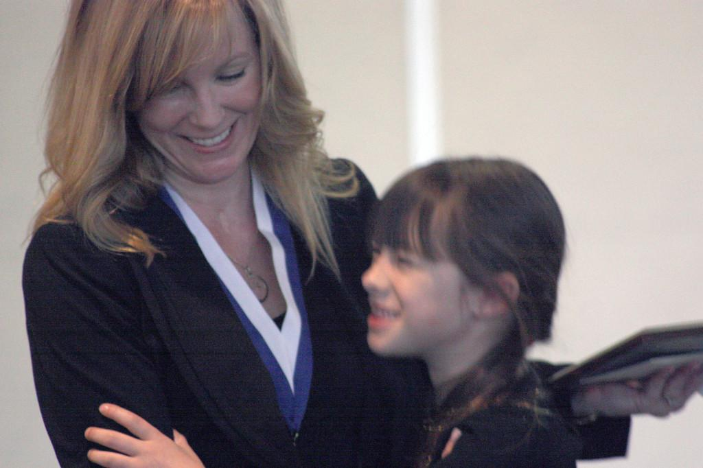 Speech instructor Angela Hoppe-Nagao hugs Sofia, her youngest daughter, after receiving the Most Outstanding Faculty award on Thursday. Hoppe-Nagao was one of twelve faculty members who were acknowledge at the Outstanding Faculty Award at the Cerritos College Student Center.