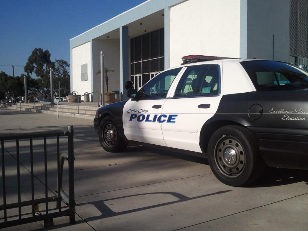 Campus squad car visibly positioned in front of the Burnight Center Theater.
