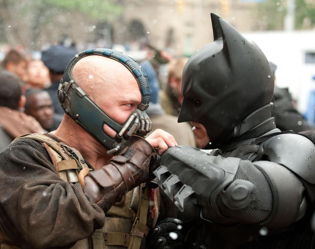 DKR-16679rC: L-r: TOM HARDY as Bane and CHRISTIAN BALE as Batman in Warner Bros