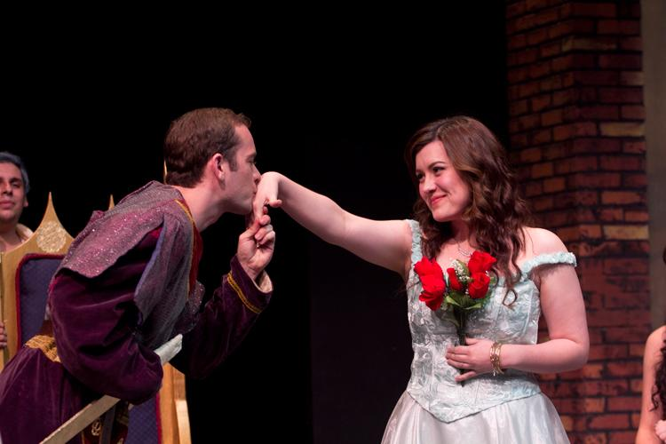 Prince Ethan (Tyler Tingley) gives a gentlemanly kiss to Princess Emmarose (Stephanie Gutierrez)