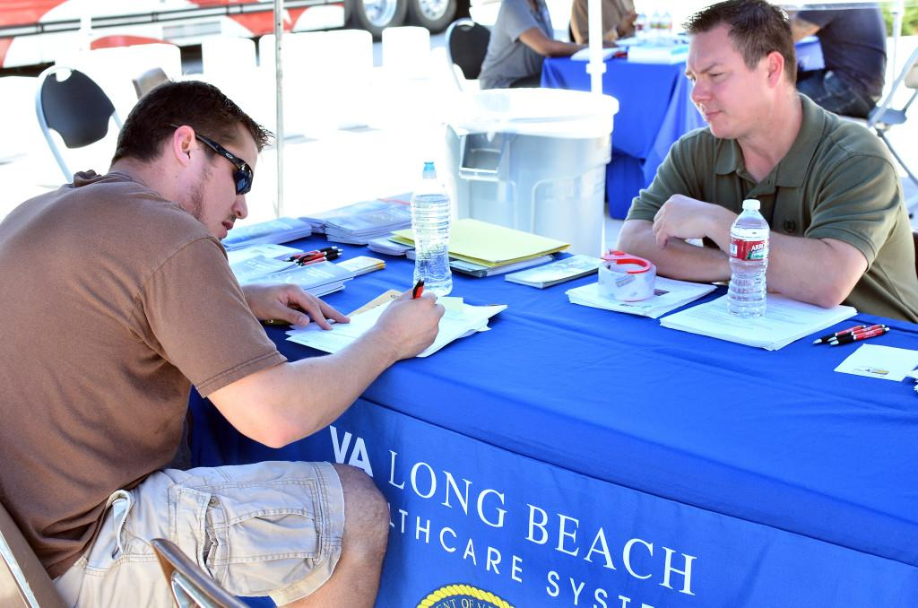 Engineering student and Veteran Chris Joly, signing up for the Long Beach Hospital program under the guidance of Nurse Case Manager, Michael Hall.