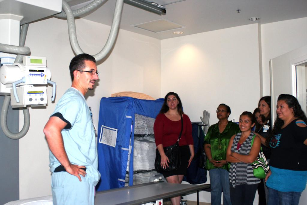 Radiology Technician Anthony Feolo, showing Project Hope students medical equipment during their tour of Kaiser Permanente hospital in Downey.