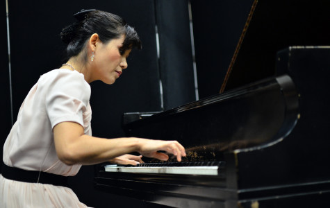 Piano instructor Sung Ae Lee playing the piano sonata
