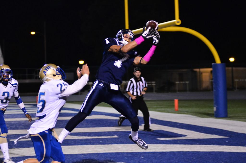 Cerritos College wide receiver No. 7 Robert Abeyta makes a leaping catch in the endzone for the touchdown. The Cerritos College football team defeats Allan Hancock College, 55-25.