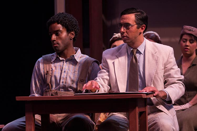 Mockingbird11.jpg –  Tom Robinson (Eric Boone) and Atticus Finch (Devon DeLamora) listen to prosecution testimony