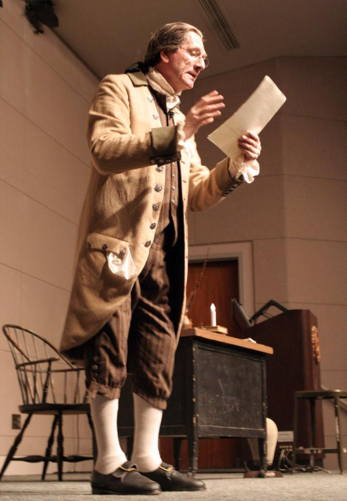 """Trained actor from the London at the Royal Academy of Dramatic Art, Ian Ruskin, performing his one-man play """"To Begin the World Over Again: The Life of Thomas Paine."""" Ruskin performed at the Teleconference Center on Oct. 10."""