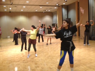 Students and staffs were taking the Zumba fitness program at the Student Center Stage