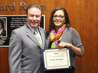 Executive Director Steve Richardson presents nursing major Darlene Rodriguez with the Carmen Solis Pratt Scholarship.