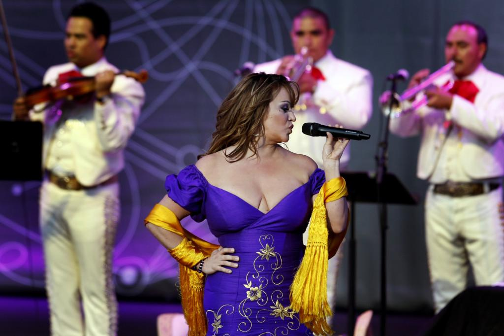 Mexican-American singer Jenni Rivera, a popular recording artist and reality television star, is feared dead after a small plane crashed early Sunday in northern Mexico. Here, Rivera, performs in Irvine, California on July 10, 2012. (Rick Loomis/Los Angeles Times/MCT)
