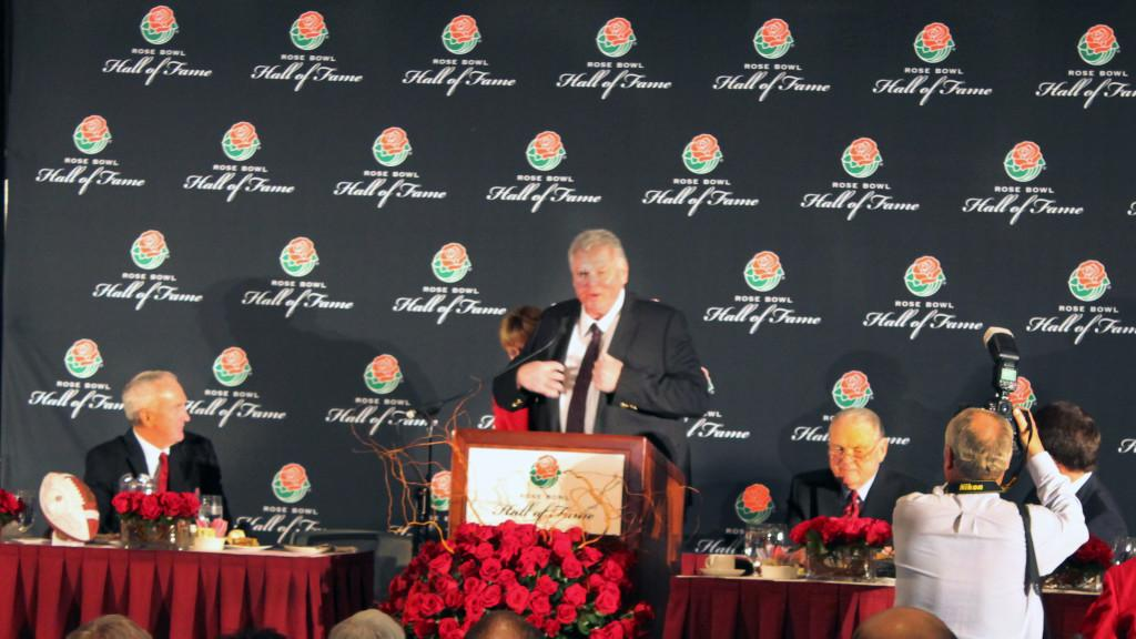 Ron Yary receiving the Rose Bowl Hall of Fame jacket from Tournament of Roses President Sally Bixby on Sunday Dec. 30 at the Pasadena Convention Center.