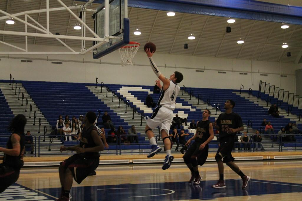 Freshman guard Kevin Conrad drives pass the Pasadena City College defense for a lay up. Conrad had 21 points, four rebounds, two assists and two steals on the night.
