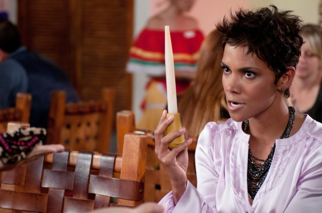 Juicin' it: Halle Berry plays around with a turkey baster. Berry is one of many stars who can be seen in the film in theaters now.