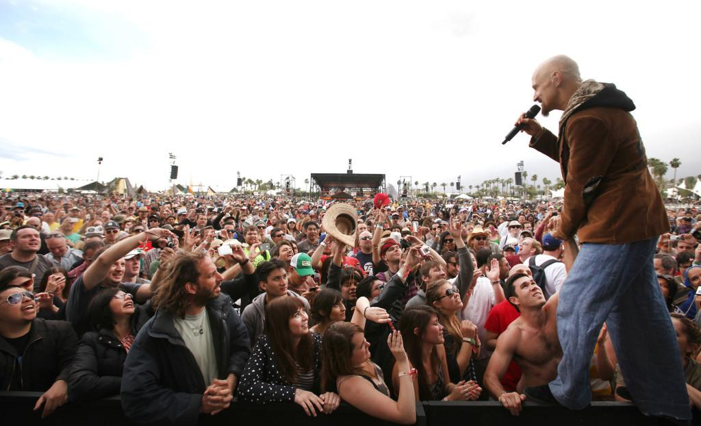 Tim Booth of James performs among fans in front of the stage at the Coachella Valley Music and Arts Festival in Indio, California, on Friday, April 13, 2012. (Brian van der Brug/Los Angeles Times/MCT)
