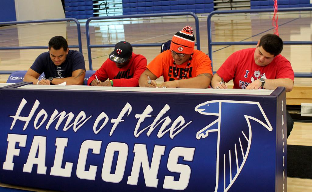 Football players sign their Letter of Intent to their four-year universities in the Falcon Gymnasium.