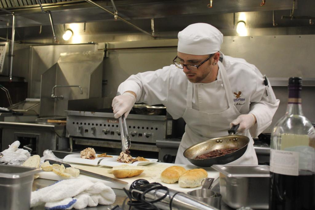 Culinary Arts major Andrew Schmalz prepares his coq au vin dish. Schamlz was one of seven participants to compete for a spot at a state wide cooking competition.