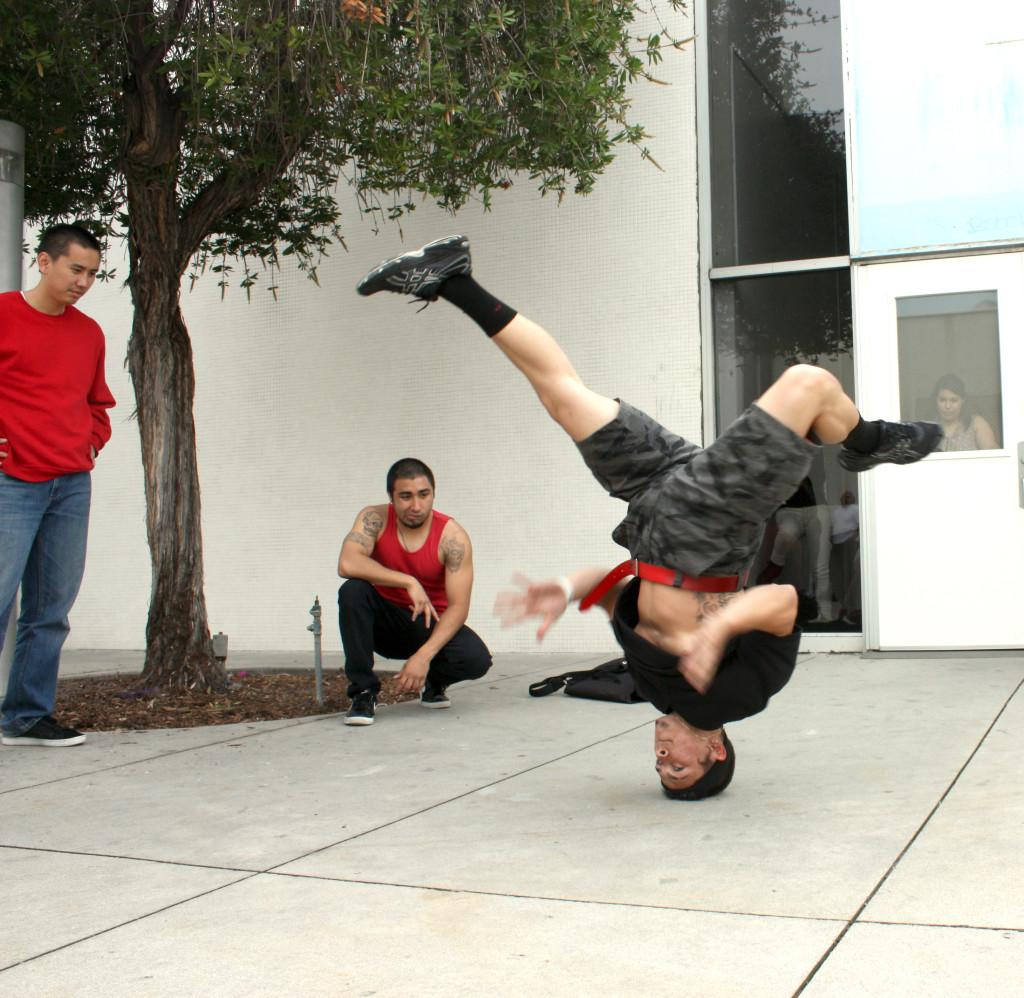 Kinesiology+major+Michael+Merced+doing+a+head+spin.+Merced+is+also+a+part+of+the+Dance+Club.+