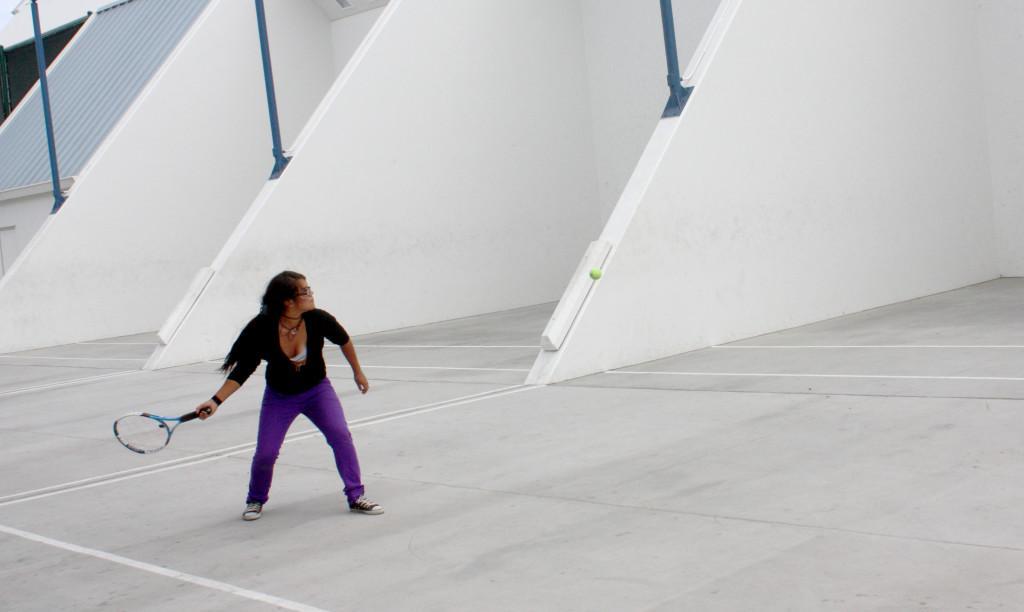 Graphic+Design+Major+Fernanda+Vazquez+takes+a+break+at+the+handball+courts.