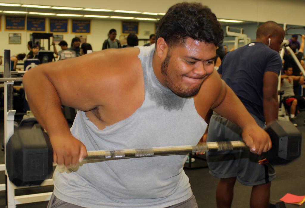 Undecided major Ace Aliimatafitafi works on his chest using the straight bar.