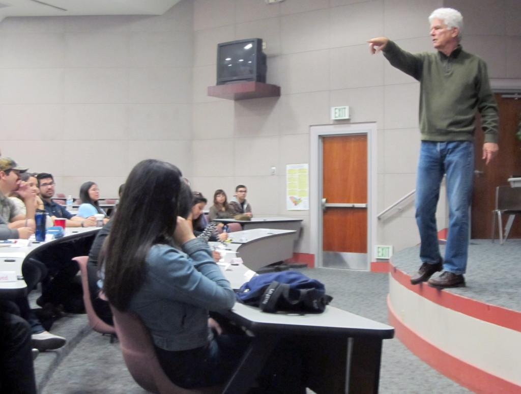 Retired professor David Young speaks to students about love via technology at the Teleconference Center on Friday.