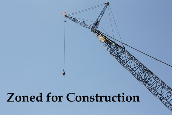 A crane is being used to move along construction of the Liberal Arts and DSPS Complex. The process is scheduled to be completed in the summer of 2014 so students can occupy classes in fall of 2014.