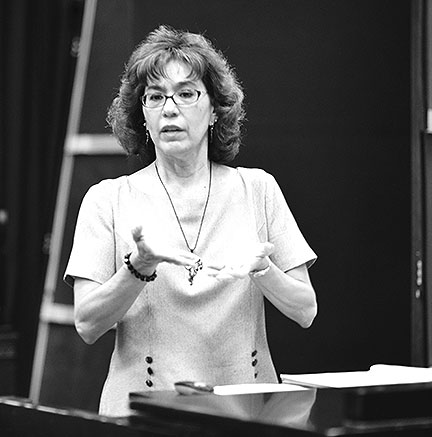 "Dr. Christine Lopez giving a lecture at the ""Do You Hear What I Hear"" music seminar in 2012."
