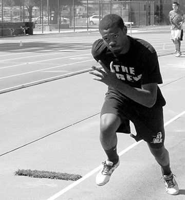 Freshman Ricky Carrigan Jr. practicing his takeoff for the triple jump. He secured his spot in the State Championships after placing fifth in the triple jump at 14.37 meters during the Southern California Championships Saturday, May 11.