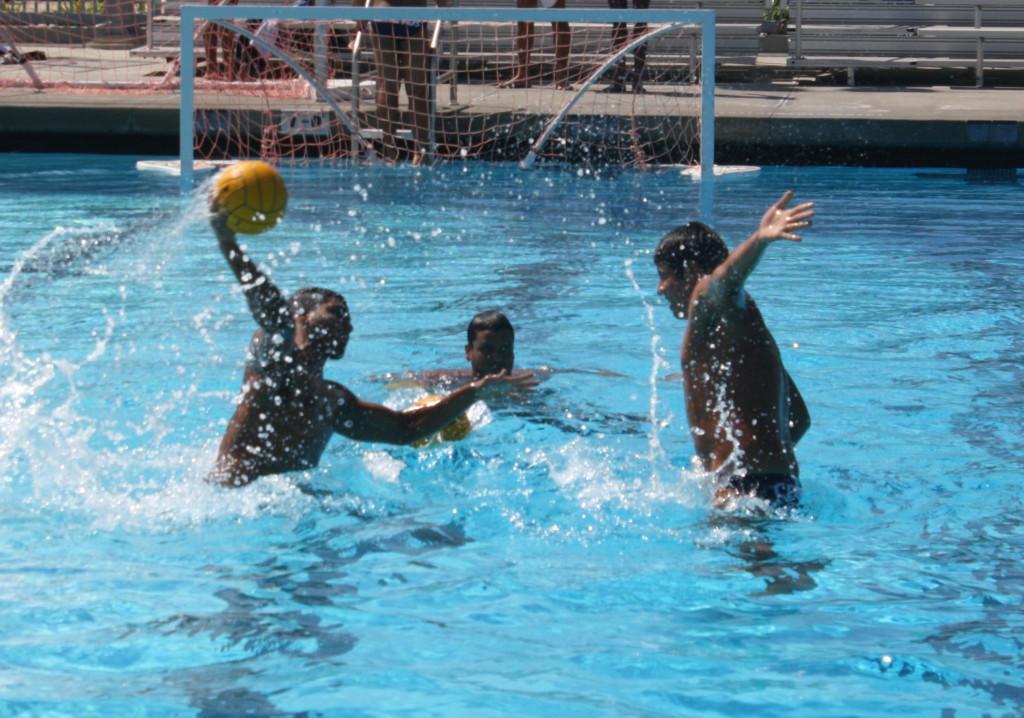 Freshman+Marlon+Moreno+attempting+a+shot+while+freshman+Alfredo+De+La+Mora+defends.