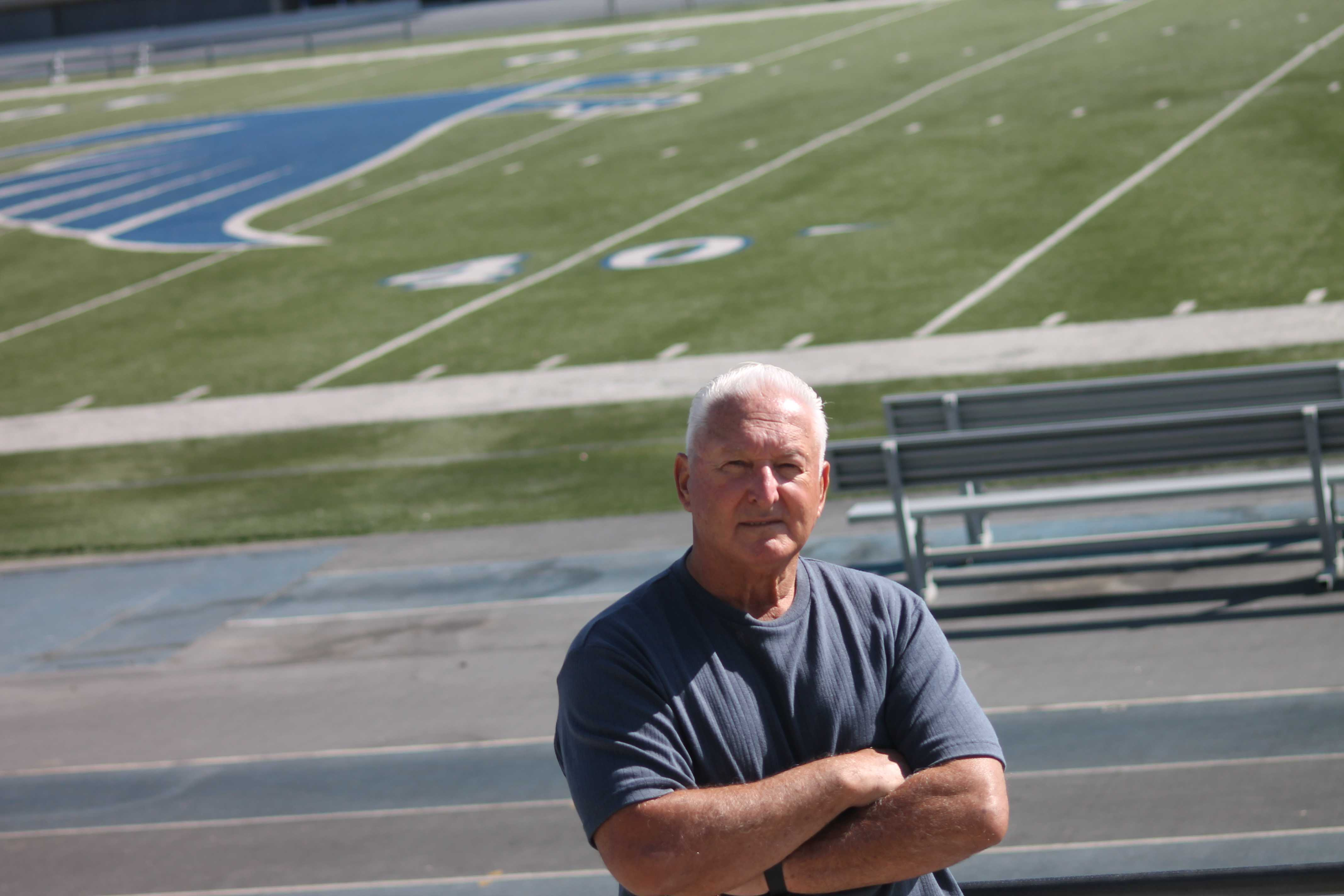 Football head coach Frank Mazzotta  standing out in the Falcon football stadium. He noted that his life centers around football and was truly an inspiration in his life.