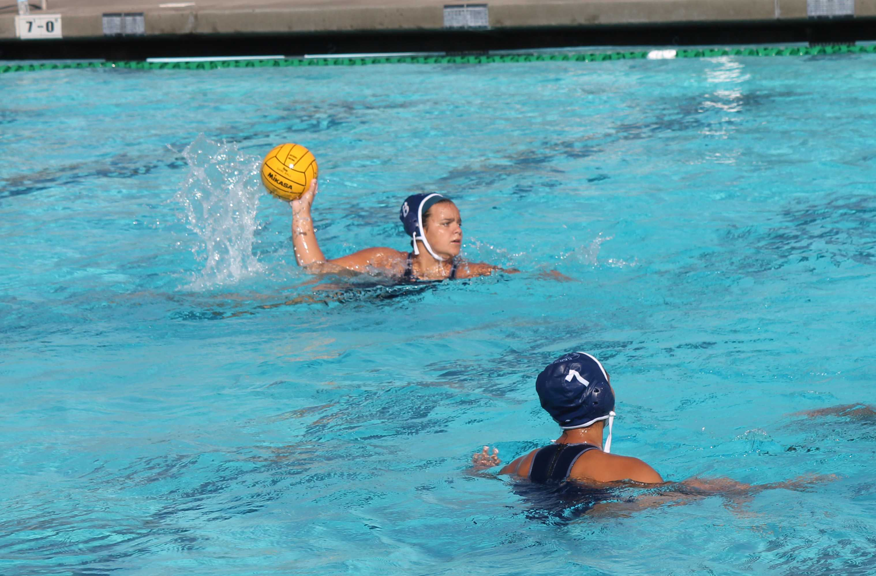 Sophomore center Catie Tuning looking to pass the ball during the women's water polo's game against Long Beach City College.