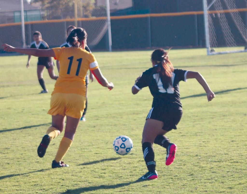 Ornelas gives chase as Herreras takes off with the ball.