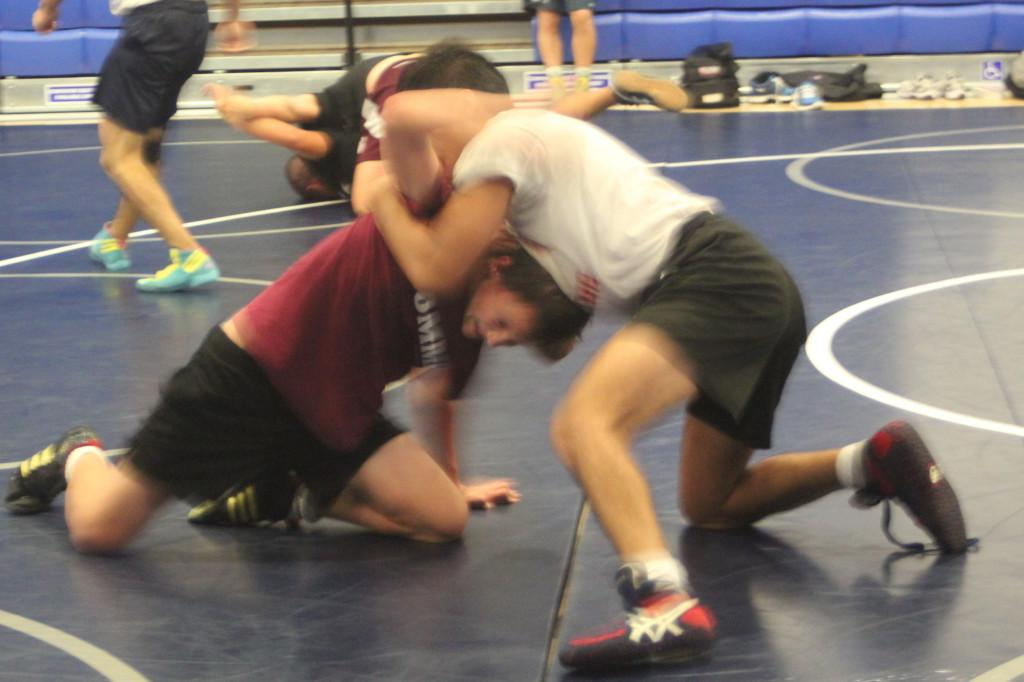 197+pound+freshman+Christian+Sanders+wrestling+during+practice.