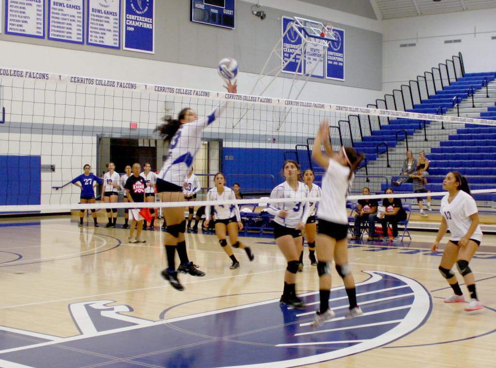 Freshman middle blocker Brianna Gutierrez spiking the ball toward Los Angeles Trade-Technical College.