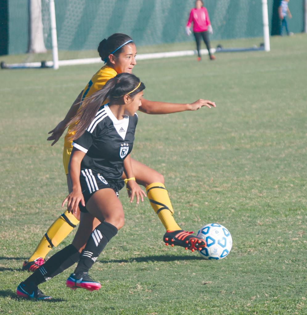 Pulido tries to pass the ball to her team mates