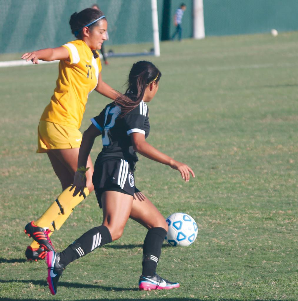 Ornelas tries to catchup to Pulido before she can pass the ball.