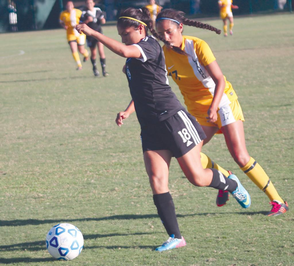 Midfielder Cristal Yantuche winds up to kick the ball down the field