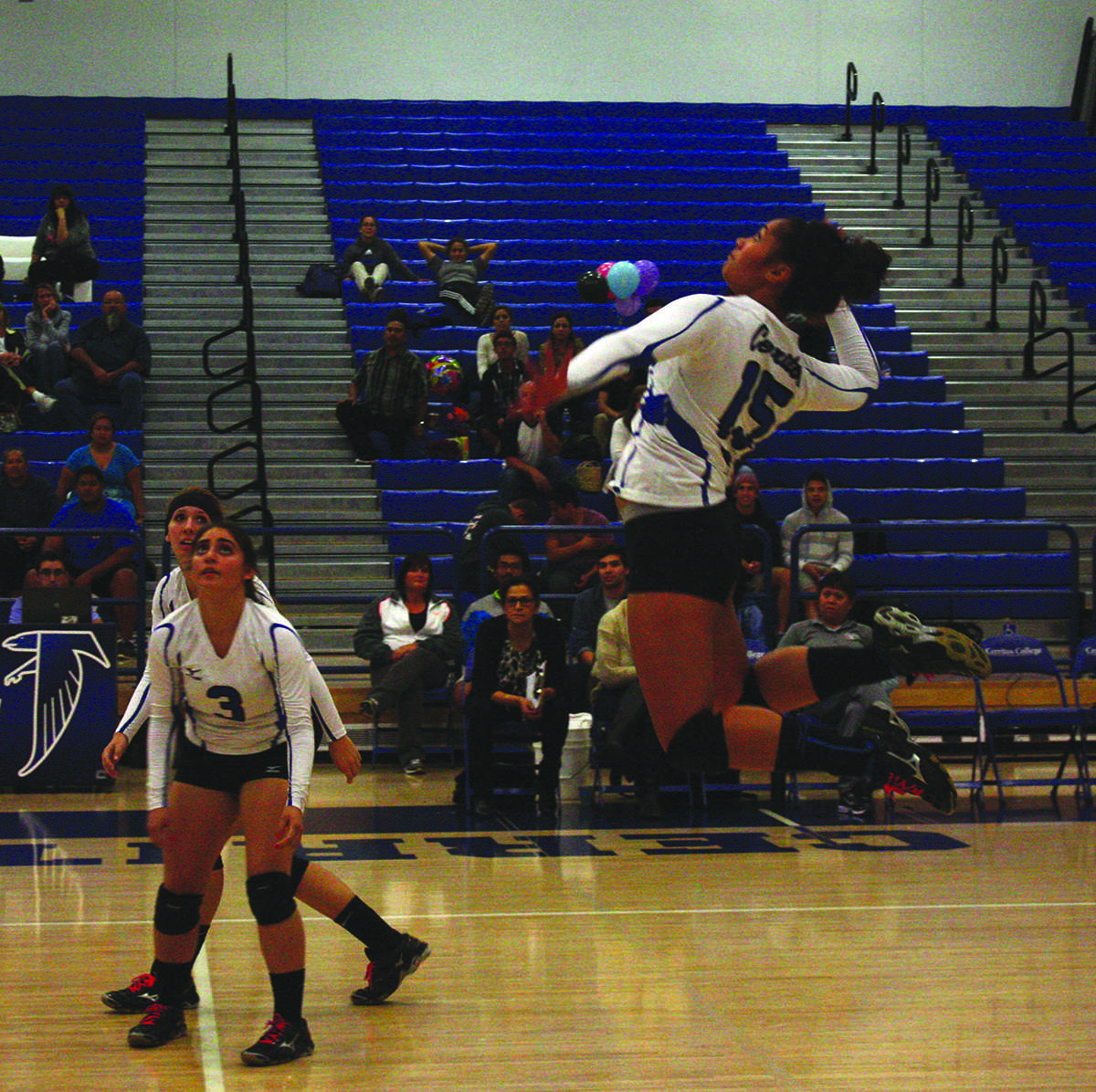Outside hitter Jasmynne Roberts goes for the kill against Los Angeles Harbor College.Photo credit: Gustavo Olguin.