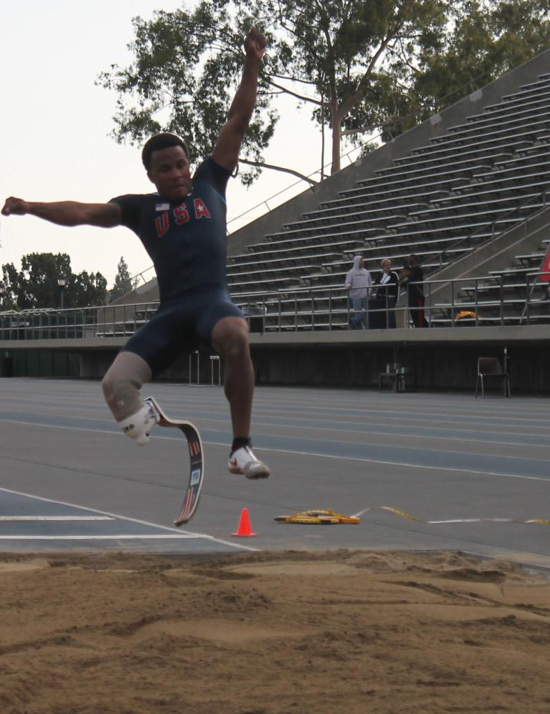 #405 in mid air while doing a long jump.