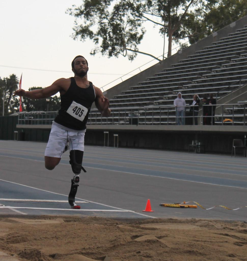 #405 is launching himself on one leg for a long jump.