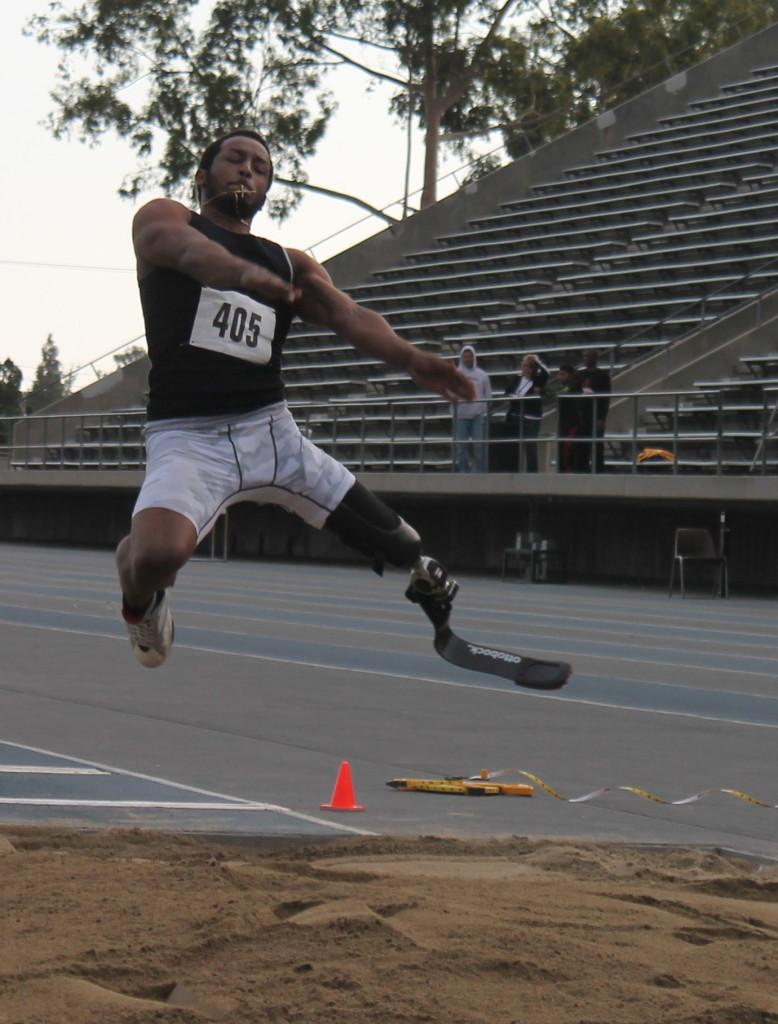 #405 is in mid-air while doing a long jump.