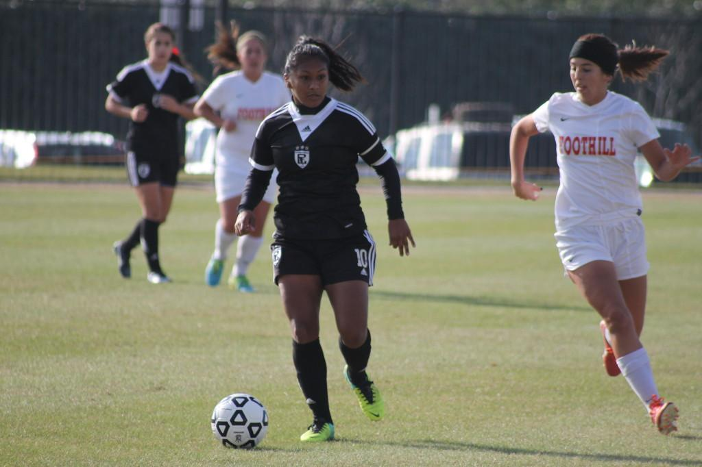 Sophomore+forward+Claudia+Lopez+studies+the+pitch+ahead+to+look+for+the+crucial+pass.Photo+credit%3A+Sebastian+Echeverry.