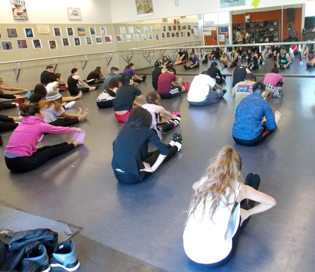 Students perform choreography during the dance audition.