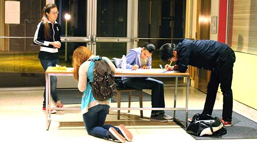 Left to right: Hilary Baca (theatre major), Aries Johnson (musical theater major), Priscilla Quinonez (theater major) and Jay Kin (theater arts major). The hopeful actors had to fill out a form before going into the audition stage. Baca was there to offer help filling out the form.Photo credit: Maria Lopez