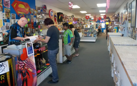 "An employee of Metropolis Comics in Bellflower helps a customer. The comic book store is hosting a fundraiser on Wednesday from 5 p.m. to 8 p.m. for 11-year-old Michael Morones who attempted to commit suicide by trying to hang himself due to liking the ""My Little Pony"" franchise.Photo credit: Alexandra Scoville"