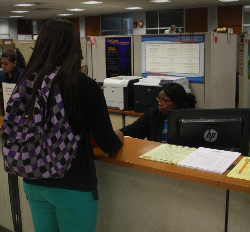 Shaquia Hughes, cosmetology major, seeking assistance from the Financial Aid Office. The Financial Aid Office is open Monday and Thursday from 8 a.m. to 4:30 p.m., and Tuesday and Wednesday from  8 a.m. to 7 p.m.Photo credit: Gustavo Olguin