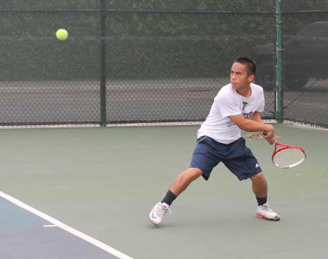 Men's tennis battle through for close win