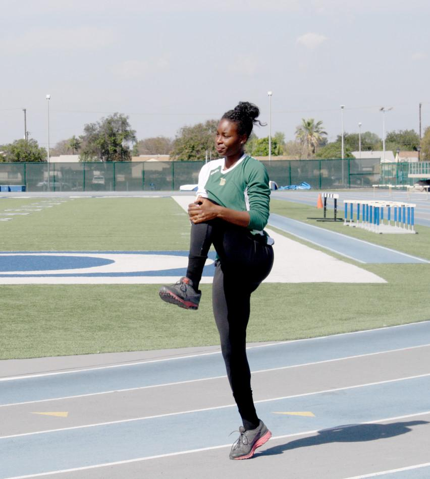 Alexus Dalton warms up before track and field practice can begin. Dalton is known to compete in seven events in just two days. Photo credit: Amairani Mendez