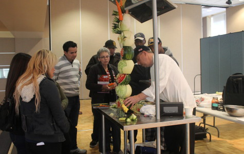 Chef Ray L. Duey demenstarting his art work with fruits and vegtables for those who participated Photo credit: Armando Jacobo
