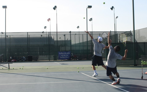 Nathan Eshmade (left) and Jose Pacquing (right) practicing their serve on Mar. 6, 2014. Photo credit: Armando Jacobo